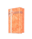 Orange gift box with ribbon and bow isolated on white Stock Photos