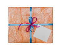 The orange gift which is elegantly packed Stock Photography