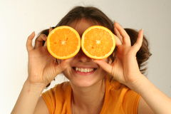 Orange girl. Young lady with orange instead of glasses, wearing orange t-shirt Royalty Free Stock Photos