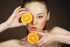 Orange girl Stock Image