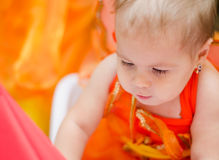 Orange girl. Portrait of a cute baby girl in an orange dress stock photos