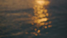 Orange glare of the sea during sunset. In Montenegro stock footage