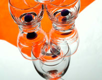 Orange glass. Bright composition from glass on orange background stock photography