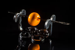 Orange glass bead on stand Stock Photos