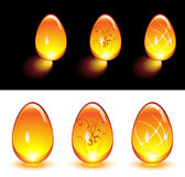 Orange Glass Eggs. Orange Easter glass eggs glowing in the dark and isolated Royalty Free Stock Photo