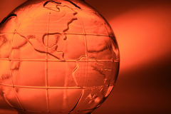 Orange glass globe Stock Photography