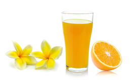 orange glass with juice and Frangipani flower Stock Photography