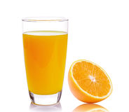 Orange and glass with juice Royalty Free Stock Images