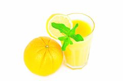 Orange and glass of orange juice with lemon slice Stock Photo