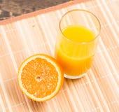 Orange and a glass of orange juice Royalty Free Stock Photos