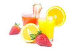 Orange, glass of orange juice, strawberries and strawberry juice Stock Photography