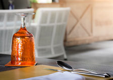 Orange Glass of water on luxury table setting Stock Images