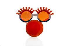 Orange glasses and horn Royalty Free Stock Image