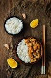 Orange glaze chicken with rice Stock Images