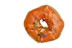 Orange Glazed Donut with Rainbow Sprinkles. A donut with orange frosting and rainbow sprinkles against a white background Royalty Free Stock Photography