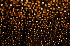 Orange Glitter background bokeh light. Shot from water drop on the windshield Royalty Free Stock Photo