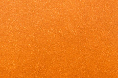 Orange glitter texture background Stock Photos