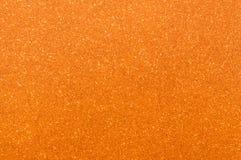 Orange glitter texture background Stock Photos
