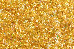Orange glitter texture christmas background. Bright golden glitter. royalty free stock photos