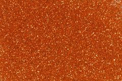 Orange glitter texture christmas background. Bright golden glitter texture. stock images