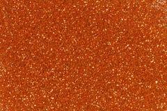 Orange glitter texture christmas background. Bright golden glitter texture. Orange glitter texture christmas background stock images
