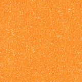 Orange glitter texture christmas background. Seamless square texture. royalty free stock image