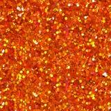 Orange glitter texture. Seamless square texture. stock image