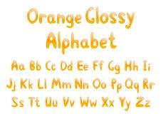 Orange glossy alphabet Stock Photography