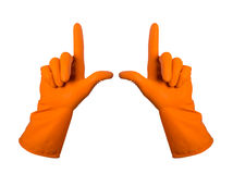 Orange gloves for cleaning on mens arm show finger up, isolated Royalty Free Stock Images