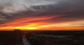 Orange Glow Cloudy Sunrise Over Morning Traffic Stock Photo