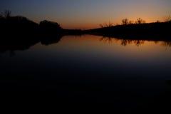 Orange glow of the setting sun Royalty Free Stock Image