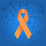 Orange glowing ribbon. Over medical blue background Stock Images