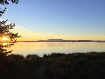 Orange, glowing sunset on a beautiful night boating in the Gulf stock image