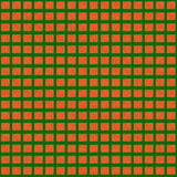 Orange gnistor på en grön bakgrund seamless modell Royaltyfria Bilder