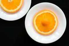 Orange godis på den orange cirkeln arkivfoton