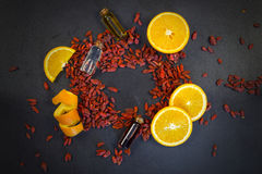 Orange, goji and essential oil spa composition Stock Photos