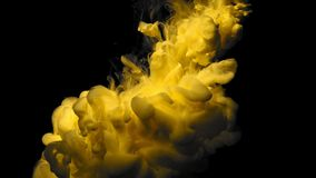 Orange with gold glitter ink in black underwater. Colour yellow paint reacting in water creating abstract cloud