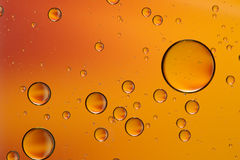 Orange and gold oil and water abstract Royalty Free Stock Photo