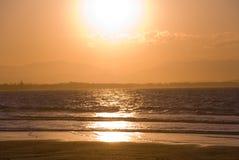 Orange Gold Sunset Byron Bay. Golden orange sunset over Byron Bay on the north coast of new south wales, Australia Stock Photo