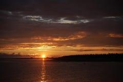Orange-gold sunset over the islands. Summer Sunset.Orange-gold sunsets into the sea islands Royalty Free Stock Photo