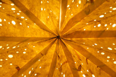 Orange golden background. Macro closeup of a shining star at xmas Stock Photo