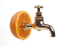 Orange with a golden tap Stock Image
