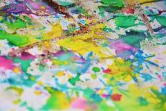 Beige gold blurred playful pastel spots, forms, abstract pastel hues. Orange golden violet beige green blue golden playful forms and spots in pastel vivid hues stock photography