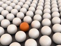 Orange golf ball. Among white balls Royalty Free Stock Images