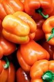 Orange grüner Pfeffer Stockfotografie