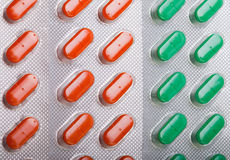 Orange-grüner Pillenhintergrund Stockfoto