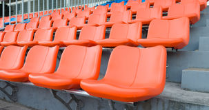 Orange grandstand chairs Stock Image