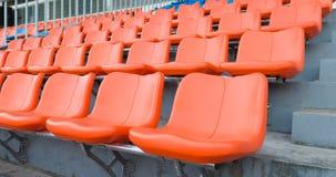 Orange grandstand chairs Stock Image