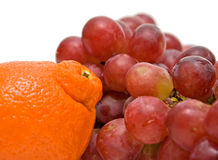 Orange and grape closeup. On white background Stock Photography