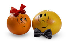 Orange and grapefruit. A shy grapefruit in love with an orange Stock Image